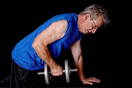 senior exercising: Senior man weight traing and exercising with weights Stock Photo