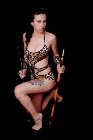 Portrait of a young and tough blond girl with a spear photo