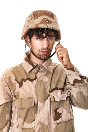Young soldier wearing desert camouflage and helmet Stock Photo - 9723874