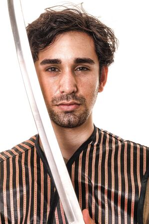 Young fierce looking man with a sword Stock Photo - 9723933