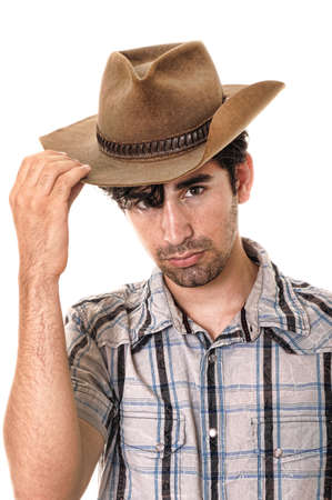 Young man wearing a cowboy hat isolated on white Stock Photo - 9724064