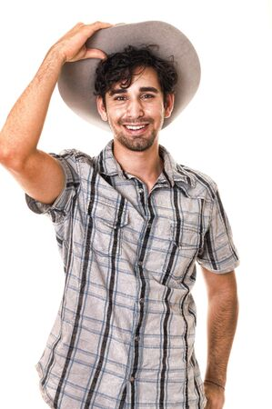 Young boy wearing a cowboy hat isolated on white Stock Photo - 9724061