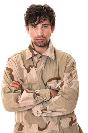 infantryman: Young soldier wearing desert camoflage isolated over white