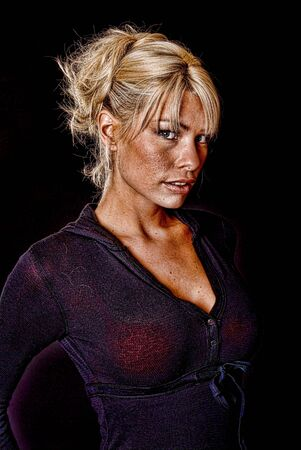 Portrait of a young and tough blond girl Imagens