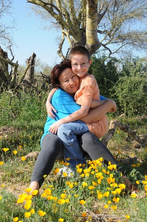 Mother and son in the Arizona spring-time desert photo