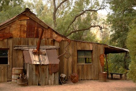 Old rustic and abandoned cabin in the southwest USA photo