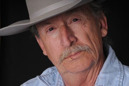 toothpick: Portrait of an old cowboy with a toothpick in his mouth