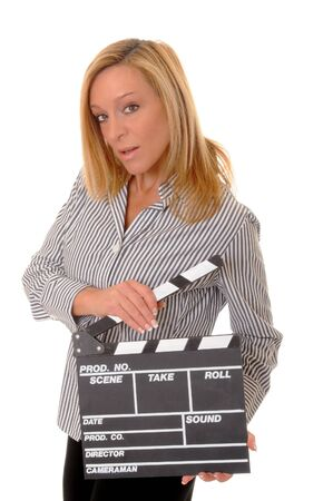 Lovely blond girl holding a clapboard photo