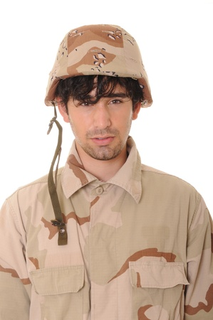 Young soldier wearing desert camouflage isolated over white 