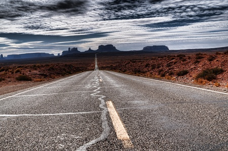 desert storm: Road into Monument Valley Utah at dawn Stock Photo