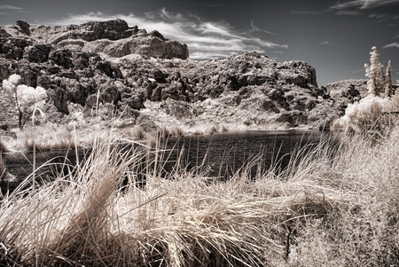 rocky mountain juniper: An Arizona desert pond rocks and mountains   Stock Photo