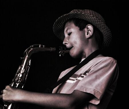 apparent: Young boy playing a saxophone, shot on film, grain apparent