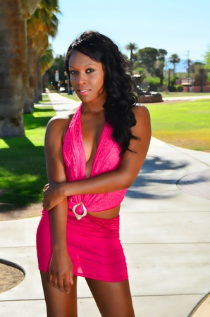 african american woman: Lovely African American girl in a hot pink dress