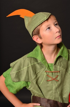 lad: Young boy dressed up in Peter Pan costume
