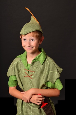peter: Young boy dressed up in Peter Pan costume