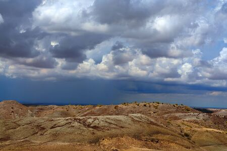 badland: Storm forming over the Arizona Badland