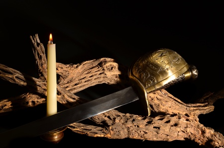 Old saber sword with candle and cholla