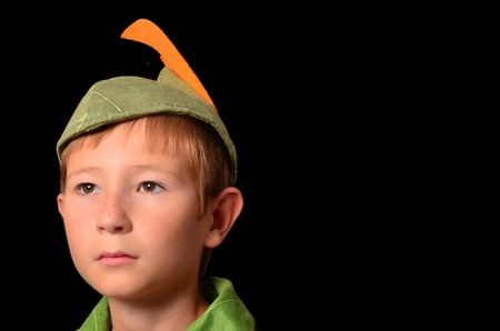 darling: Portrait of a Young boy dressed up in peter pan costume