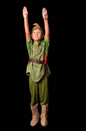 Flying Young boy dressed up in peter pan costume photo