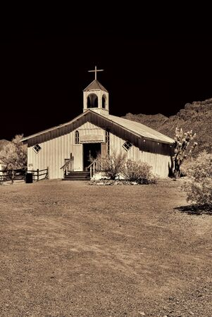Sepia toned old time western wooden church photo
