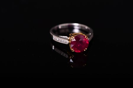 platinum: Ruby and diamond platinum ring isolated over black