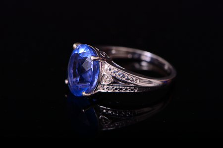 platinum: Chinese Blue Florite and Platinum Ring isolated over black