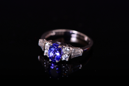 tanzanite: Tanzanite And Diamond Platinum Ring isolated over black