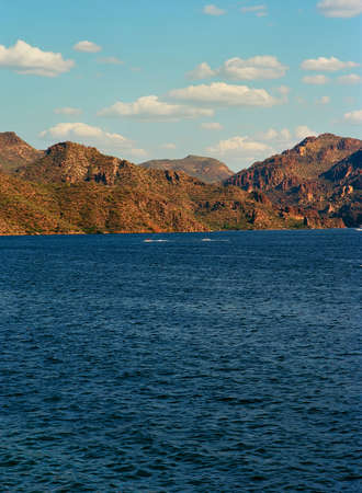 Boaters on Arizona Desert Lake Surrounded by mountains
