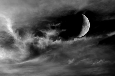 Monochrome image of moon and clouds at night