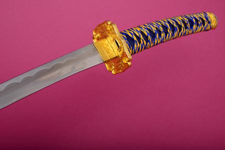 wakizashi: Samurai sword, Katana, Wakizashi and Tanto, isolated on pink background Stock Photo