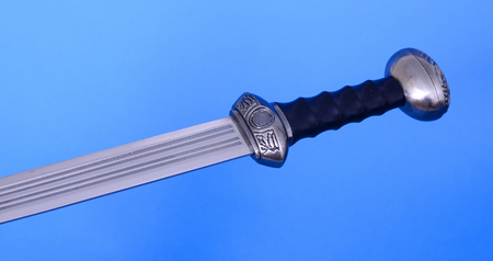 hilt: Gladius blade, guard, and hilt isolated over blue