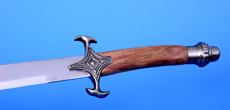 hilt: Scimitar blade, guard, and hilt isolated over blue