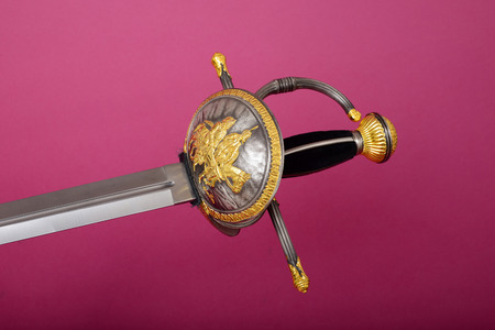 rapier: Rapier blade, guard, and hilt isolated over lavender