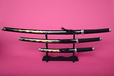 hilt: Samurai swords guard, and hilt isolated over pink Stock Photo