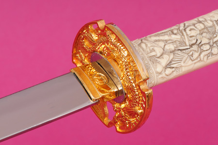 wakizashi: Samurai sword, Katana, Wakizashi and Tanto, isolated on pink backgroun Stock Photo