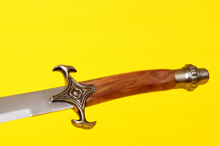 hilt: Scimitar blade, guard, and hilt isolated over yellow