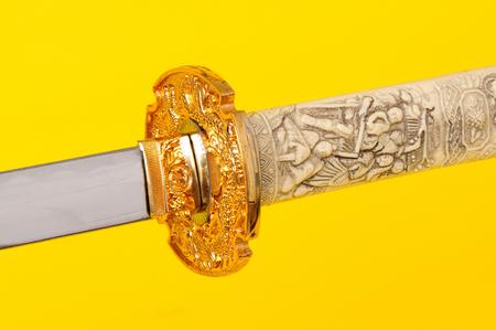 wakizashi: Samurai sword, Katana, Wakizashi and Tanto, isolated on yellow background