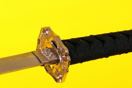 wakizashi: Samurai sword, Katana, Wakizashi and Tanto, isolated on Yellow background Stock Photo