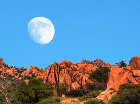 southwestern: Desert moon over the southwestern USA desert and mountains