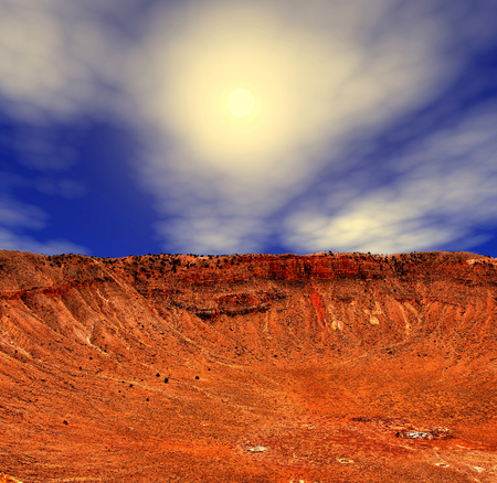 Meteor crater in Arizona with background sun