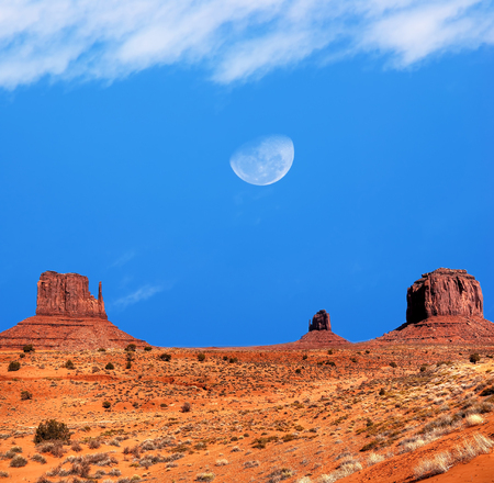 gibbous: Large gibbous moon over Monument Valley Arizona Stock Photo