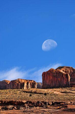 gibbous: Gibbous Large moon over Monument Valley Arizona