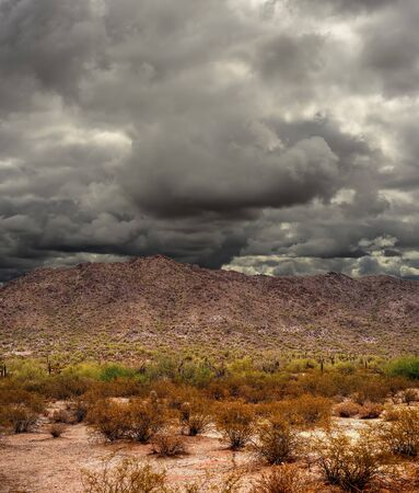 desert storm: Storm forming Sonora desert mountains in central Arizona USA Stock Photo