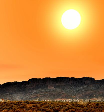 beneath: Sunrise at Desert City beneath cliffs Arizona