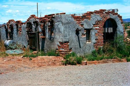 Old weather beaten brick shack in the desert