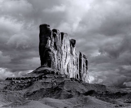 apparent: Shot on film, grain apparent, Monument Valley Arizona with evening cloudy skies
