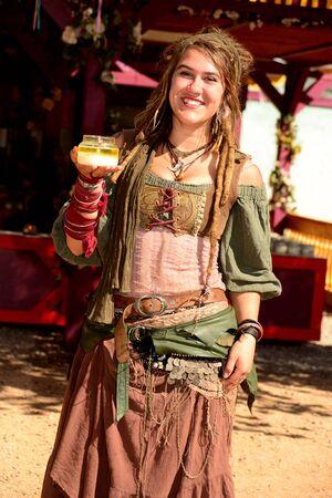 period costume: Phoenix, Arizona, United States, February 14 2016 Participants attending Arizona Renaissance Festival dressed in period costume. Editorial