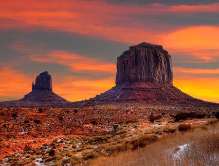 navajo land: Monument Valley Arizona with evening sunset skies Stock Photo