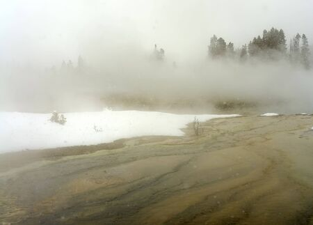 winter park: Geothermal pool in winter Yellowstone National Park