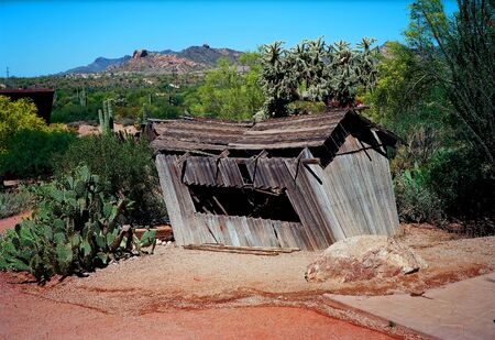 sturdy: Old weather beaten wooden shack in the desert